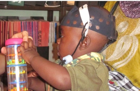 A lightweight cap measures a young chid's brain activity (credit: Clare Elwell)