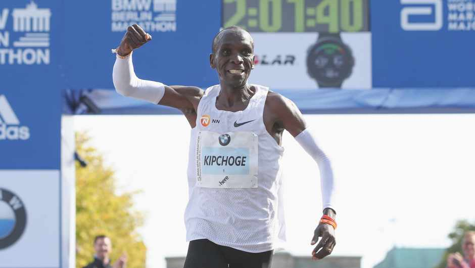 Eliud Kipchoge of Kenya crosses the finishing line to win the Berlin Marathon 2018 in a new world record time of 2:01:40 hours (later officially annouced by organisers to be 2:01:39) on September 16, 2018 in Berlin, Germany.  (Photo by Maja Hitij/Bongarts/Getty Images)
