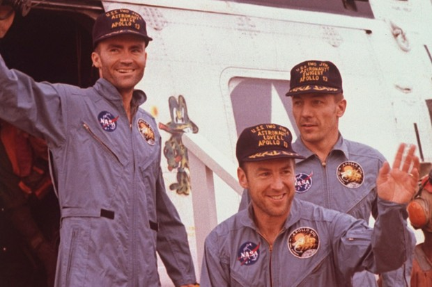 Apollo 13 astronauts Fred Haise, Jim Lovell & Jack Swigert waving as they emerge from rescue helicopter after ill-fated moon mission (© Time Life Pictures/NASA/The LIFE Picture Collection/Getty Images)