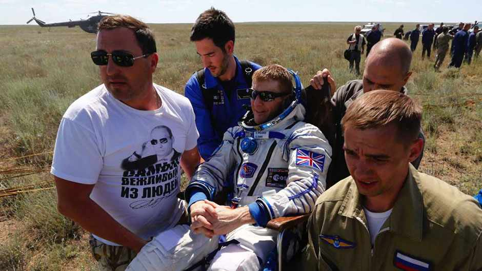 Ground personnel carry International Space Station (ISS) crew member Tim Peake of Britain shortly after landing near the town of Zhezkazgan, Kazakhstan, on June 18, 2016 © Shamil Zhumatov/AFP/Getty Images