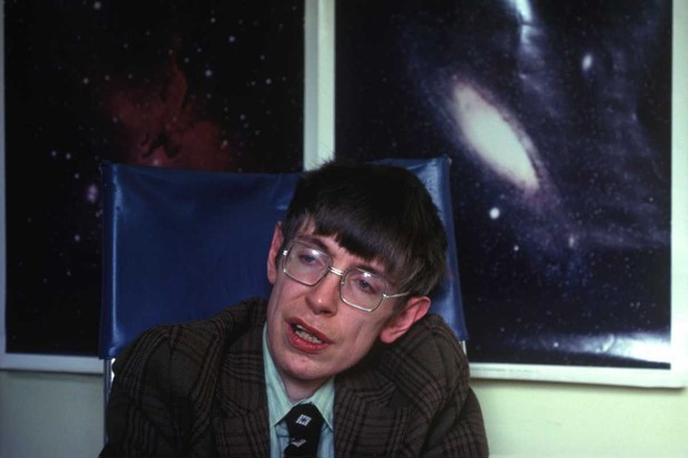 Professor Stephen Hawking in his office at the Department of Applied Mathematics and Theoretical Physics at the University of Cambridge, circa 1990 © Romano Cagnoni/Getty Images