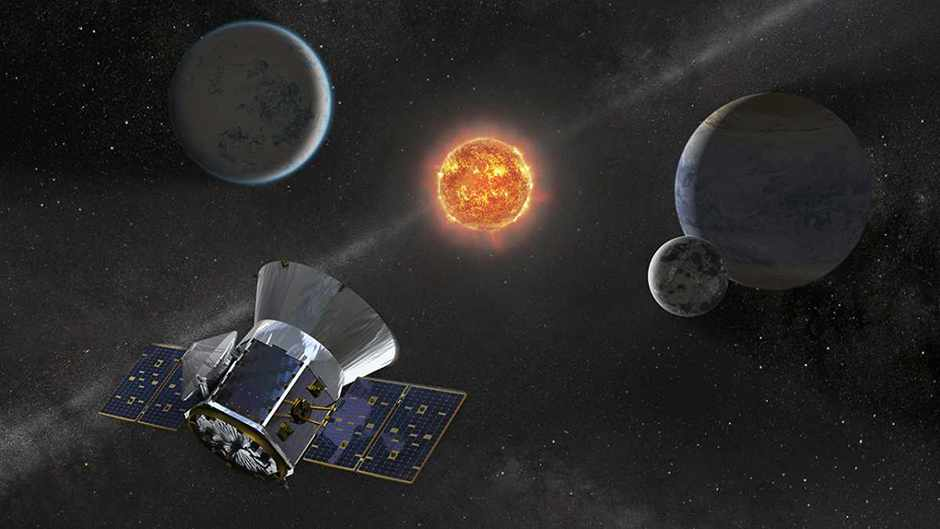 Illustration of NASA's Transiting Exoplanet Survey Satellite -- TESS -- observing an M dwarf star with orbiting planets © NASA