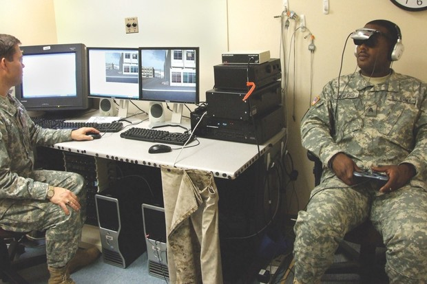 Army Colonel Michael J Roy oversees the 'Virtual Iraq' exposure therapy at Walter Reed Army Medical Center, demonstrating a life-like simulator that represents a new form of PTSD treatment (© US Army)
