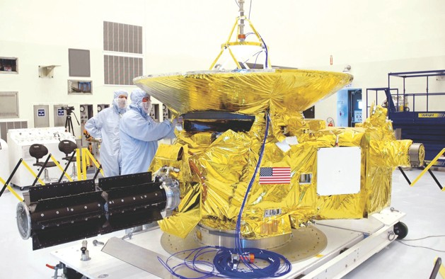 The New Horizons craft was assembled in a clean room prior to its launch aboard an Atlas V rocket (credit: NASA)