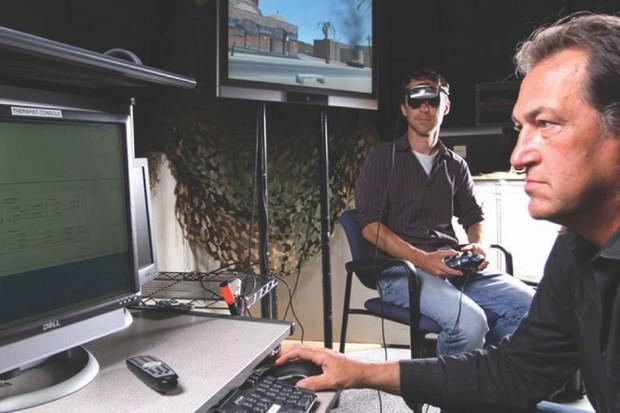 Skip' Rizzo (right) demonstrates the Bravemind VR system (© Branimir Kvartuc)