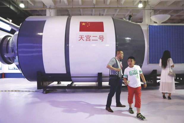 Visitors walk in front of a replica of Tiangong-2 space laboratory on display at the China Beijing International High-Tech Expo (CHITEC) in Beijing, China, 08 June 2017 © How Hwee Young/EPA/REX/Shutterstock