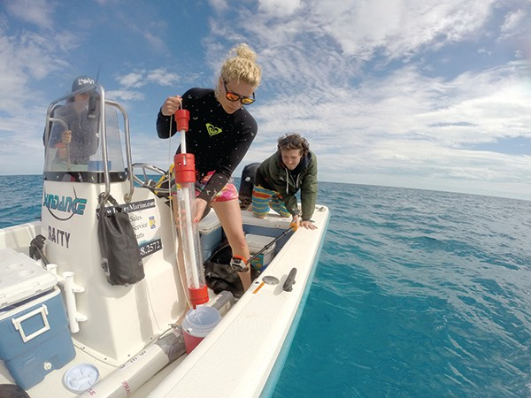 Judith Bakker collecting samples of seawater for the eDNA material it contains © Angelo Villagomez