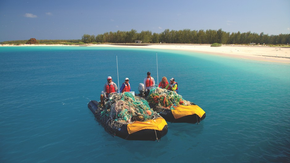 How safe are our Marine Protected Areas? (A marine debris team collects fishing nets that have been abandoned in the Papahānaumokuākea Marine National Monument © NOAA)