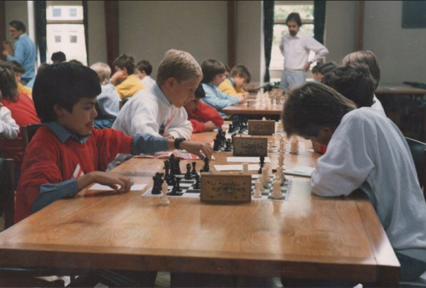 Demis (L) captaining the England under-11's chess team aged 9