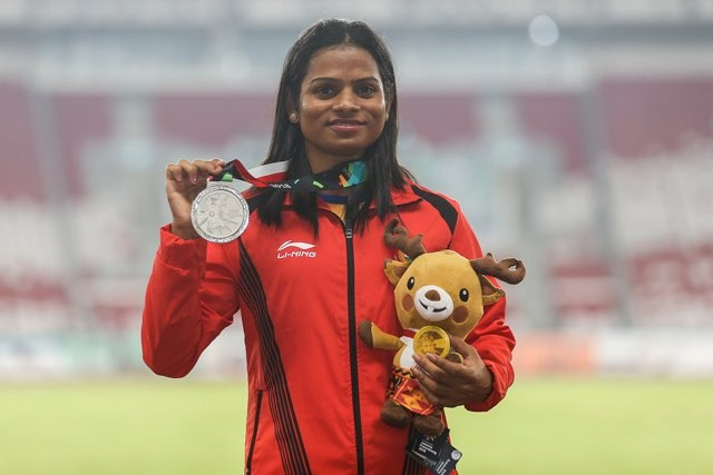 Silver medalist Dutee Chand of India poses for photo during Athletics WomenÕs 200m medal ceremony at GBK Main Stadium on day eleven of the Asian Games on August 29, 2018 in Jakarta, Indonesia. (Photo by Yifan Ding/Getty Images)