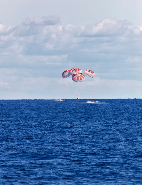 SpaceX's Crew Dragon is guided by four parachutes as it splashes down in the Atlantic Ocean about 200 miles off Florida's east coast on 8 March 2019, after returning from the International Space Station on the Demo-1 mission © NASA