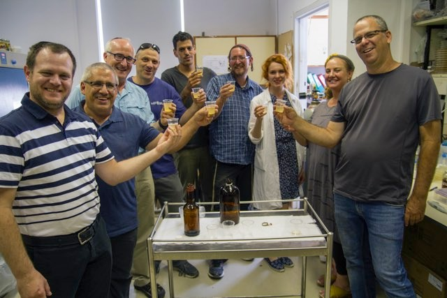 L'chaim! The Israeli research team samples their ancient brew. © Yaniv Berman, Israel Antiquities Authority.