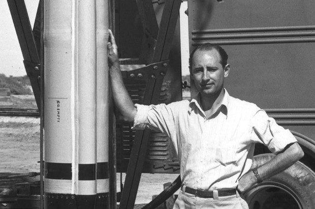 Frank Joseph Malina, a co-founder of the Jet Propulsion Laboratory, gives scale to an early model of the WAC Corporal research rocket. The associated steelwork is the lower section of the vertical launch tower. © Universal Images Group / Getty Images Plus