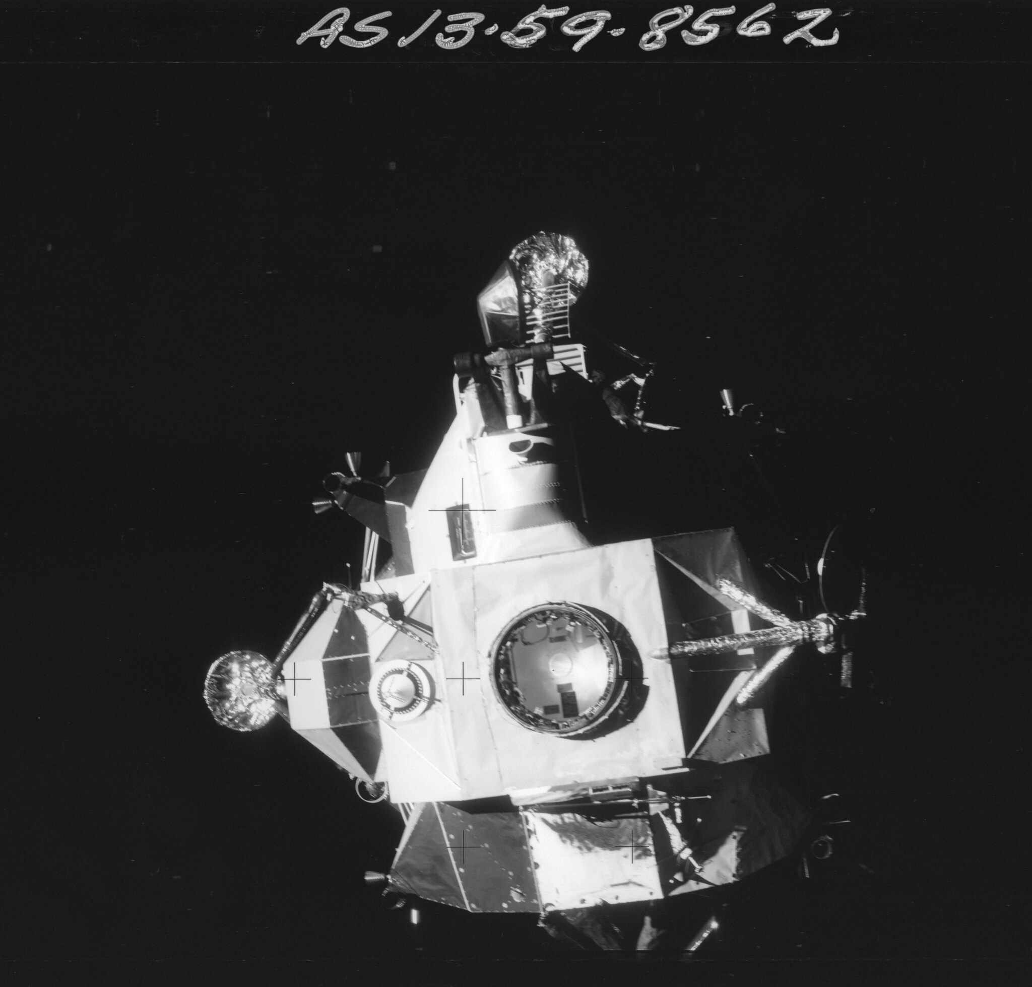 AS13-59-8562 Apollo 13 Hasselblad image from film magazine 59/R - Transfer from LM to CM; LM undocking prior to reentry