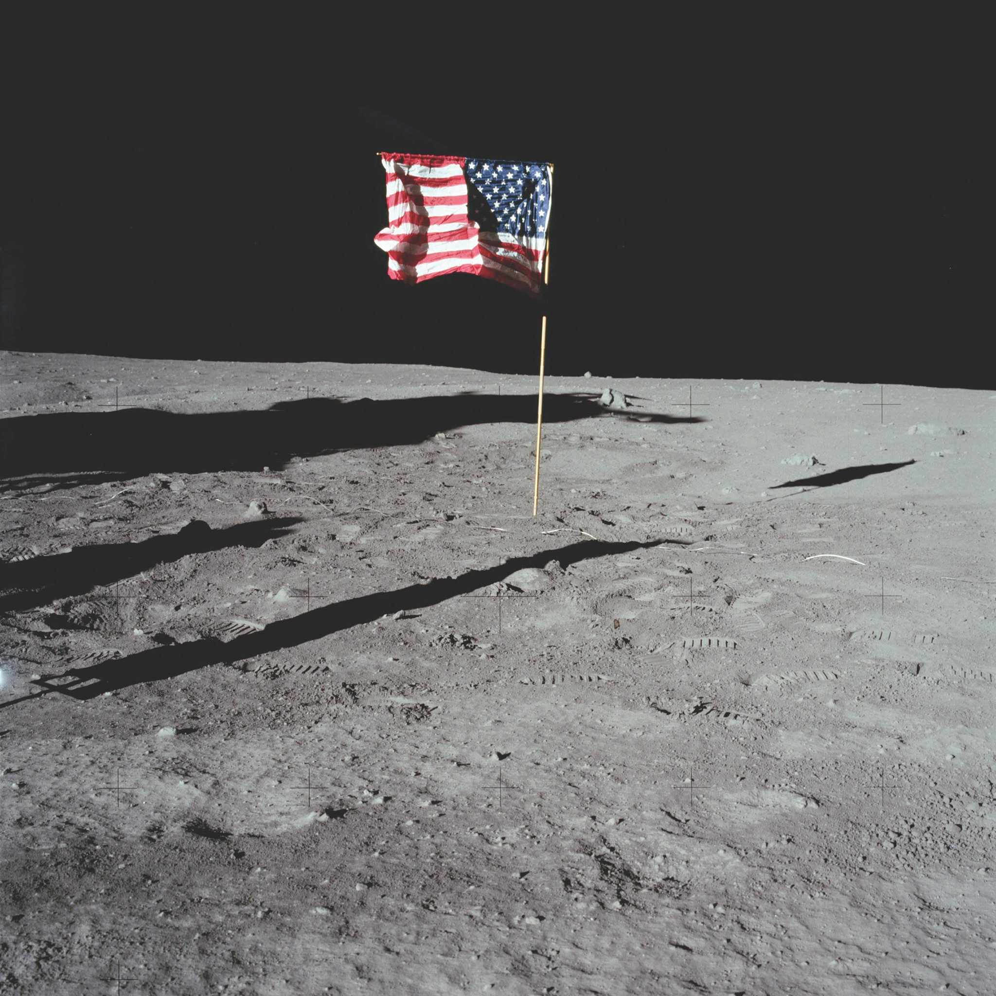 Around 90 minutes into his moonwalk, Buzz Aldrin took this photo of the American flag planted in the lunar landscape © NASA/JPL