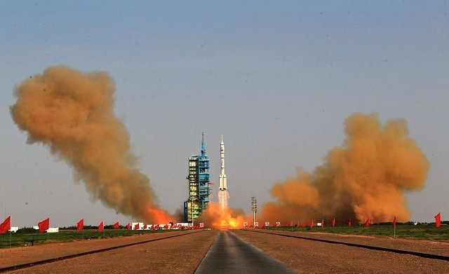 A Long March 2F rocket carrying Shenzhou-9 manned spacecraft blasts off from the Jiuquan Satellite Launch Center on June 16, 2012 in Jiuquan, China. The Shenzhou-9 manned spacecraft carrying three crew members was launched at 6:37 p.m. (1037 GMT) to perform the country's first manned space docking mission with the orbiting Tiangong-1 unmanned space lab, which was launched last September. (Photo by VCG/VCG via Getty Images)