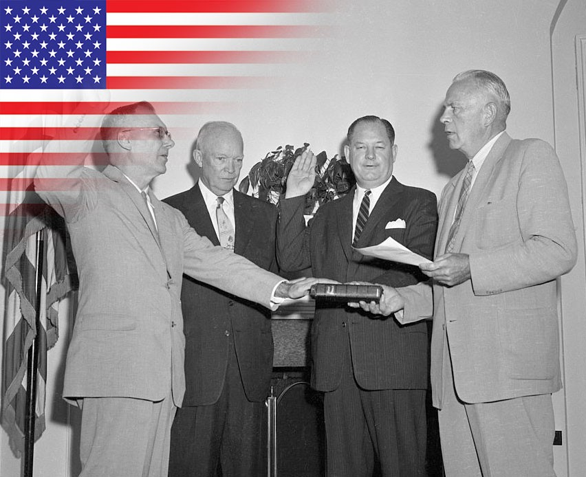 New space agency NASA begins operations. (President Eisenhower presents Commissions of Office to Dr. T. Keith Glennan, of Cleveland (right) administrator of the new National Aeronautics and Space Administration, and Dr. Hugh L. Dryden (left) of Washington, deputy administrator © Getty Images)