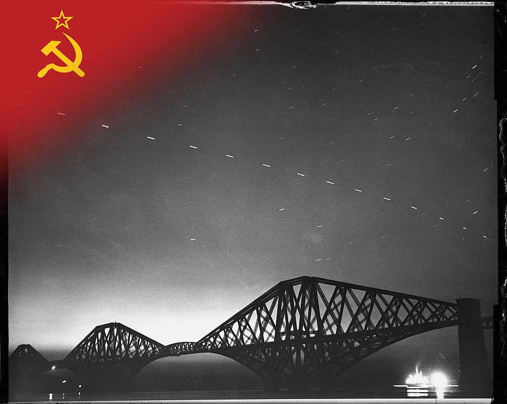 Sputnik 3, weighing over a tonne, launches into orbit. (View of light trails caused by the orbit of Soviet-launched Sputnik 3 satellite, as seen above the Forth Rail Bridge, which connects Edinburgh with Fife, Scotland, July 1958. © Morris Allan/Getty Images)