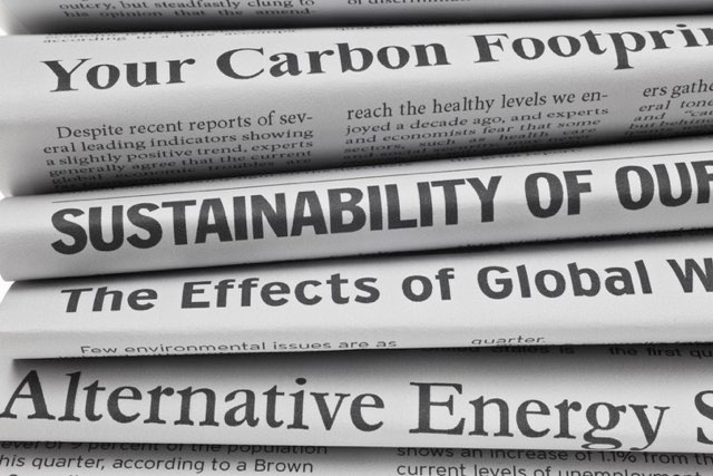 Newspapers covering climate change © Getty Images