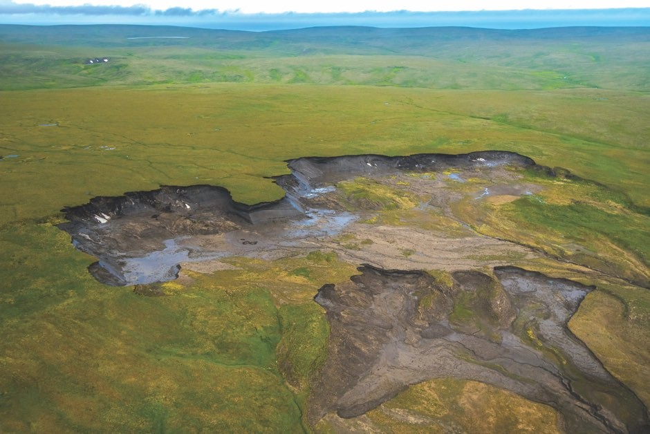 Here, a huge dip in the ground can be seen where the Arctic permafrost in Herschel Island, Canada, has melted © Getty Images