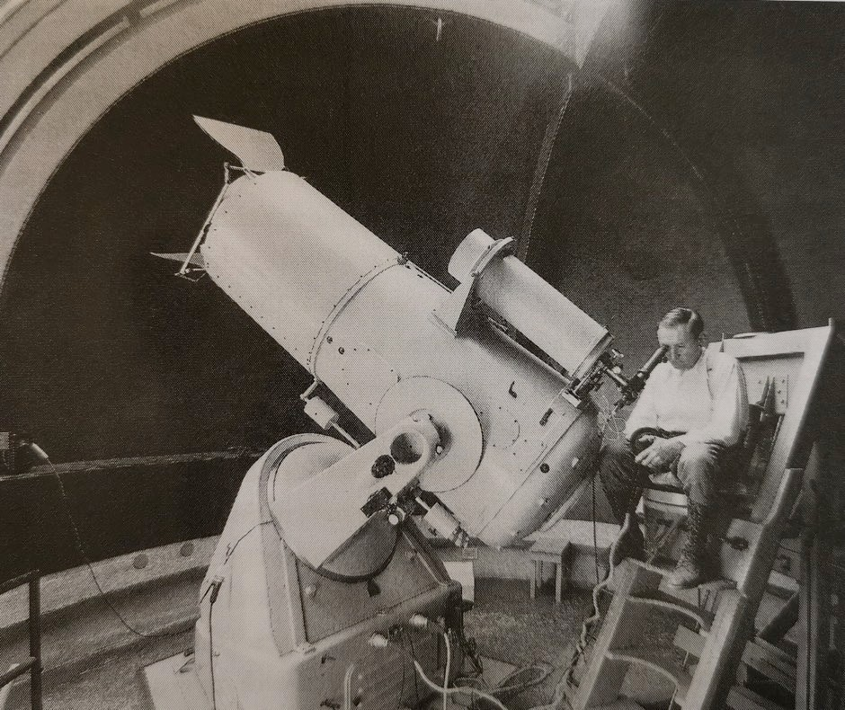 Zwicky working on the 18-inch telescope at Mt. Palomar