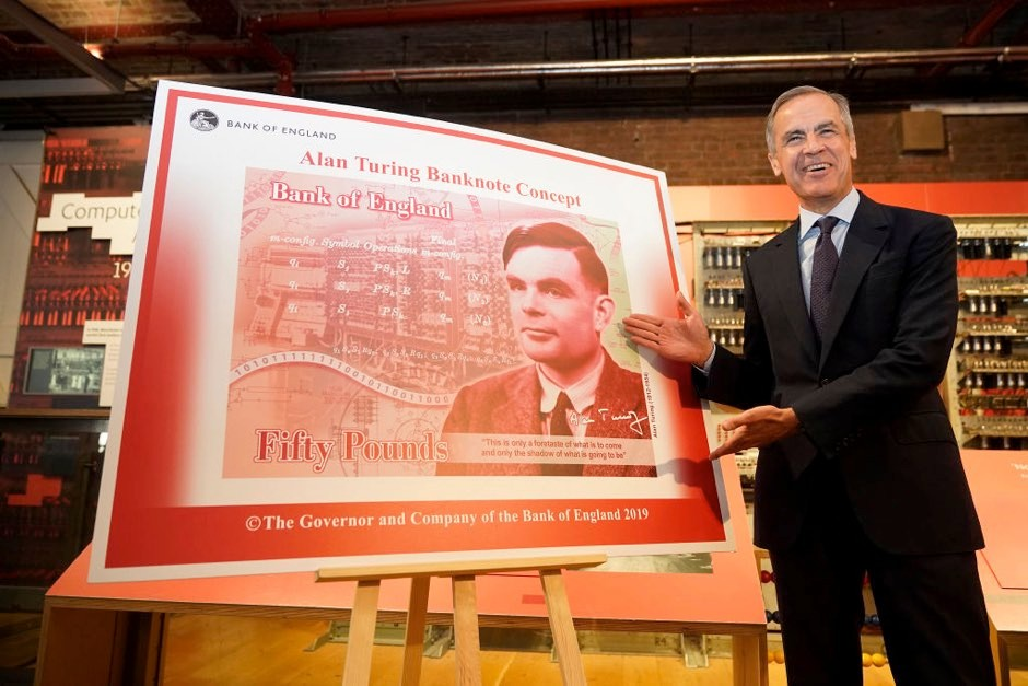 The Governor of the Bank of England, Mark Carney reveals Alan Turing as the new figure to be depicted on the 50 GBP note at the Manchester Science and Industry Museum on July 15, 2019 in Manchester, England. The general public were asked to 'Think Science' and nominate characters from the field of science for the next £50. Turing was selected from over 200,000 nominations for nearly 1000 eligible scientists. (Photo by Christopher Furlong/Getty Images)