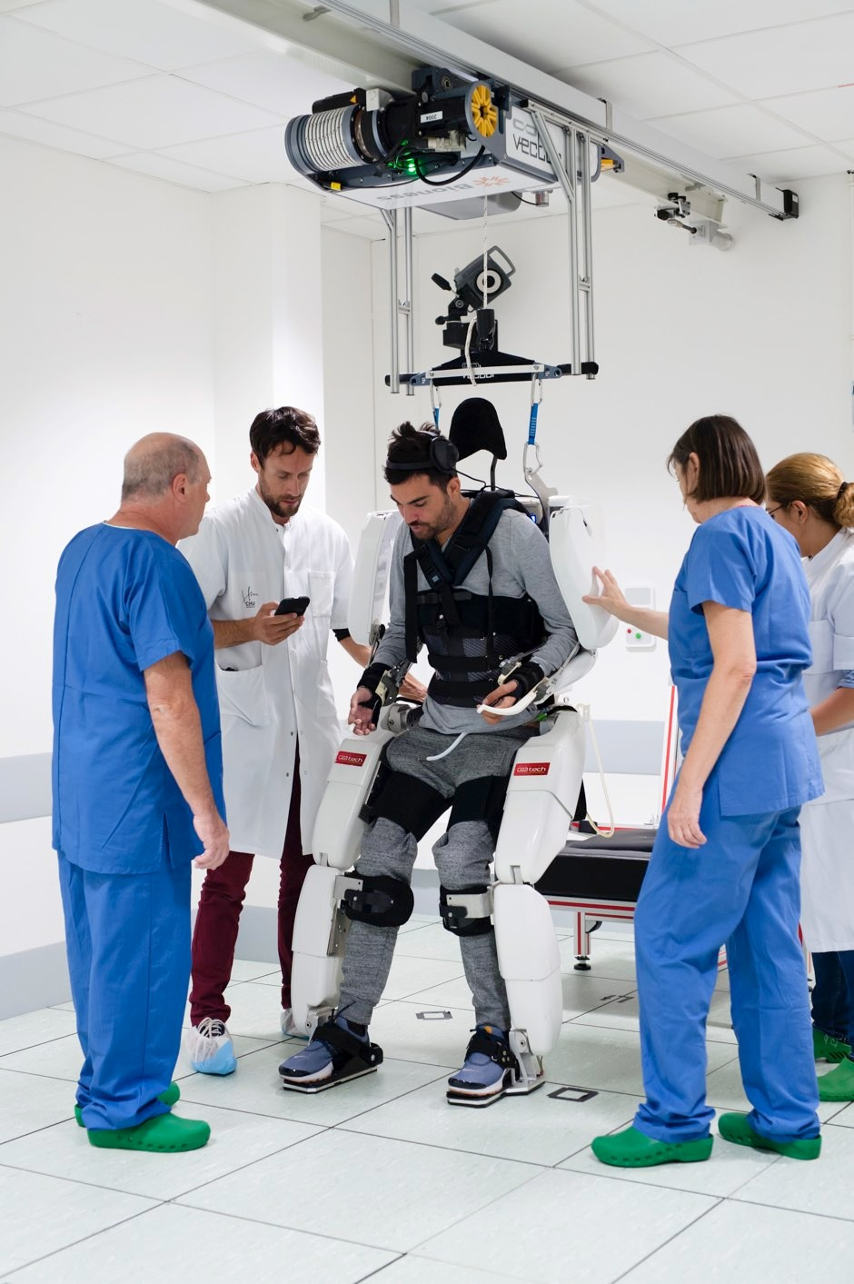 Thibault is able to walk while wearing an exoskeleton controlled by his brain signals © Clinatec/Juliette Treillet/PA