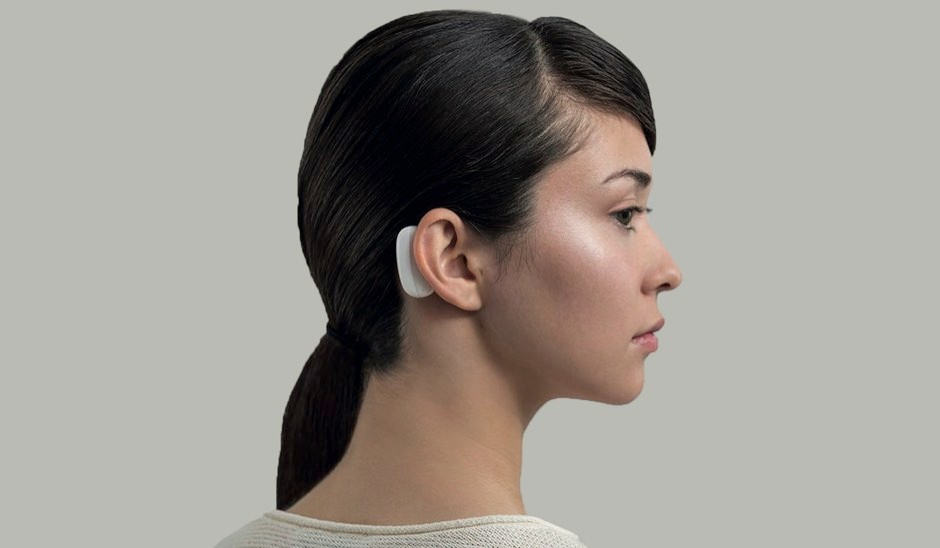 'The Link', a small wearable device, sitting behind the ear © Neuralink