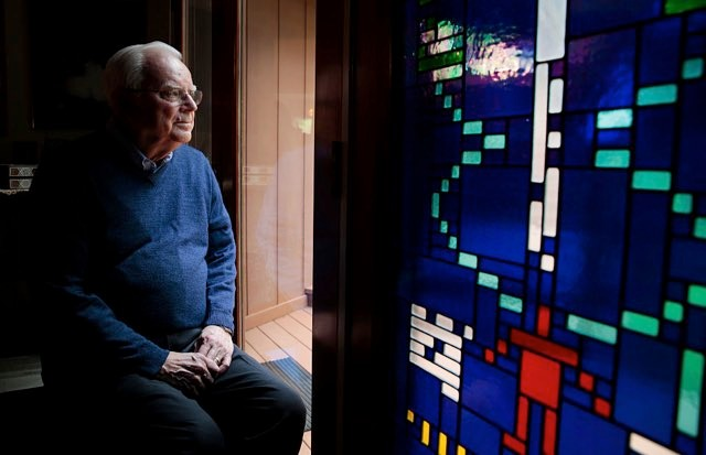 Dr Frank Drake next to a stained glass window with the Arecibo Message © Ramin Rahimian for The Washington Post via Getty Images