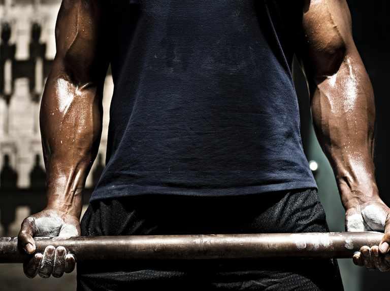 Why do bodybuilders often get protruding veins?