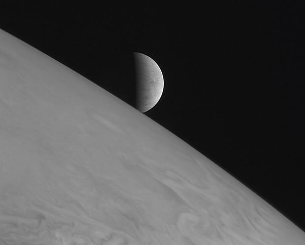 Europa rising above Jupiter's cloud tops © NASA/JPL