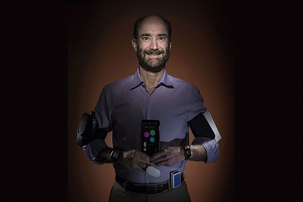 Study leader Prof Michael Snyder with several wearable health devices © Steve Fisch/Stanford University