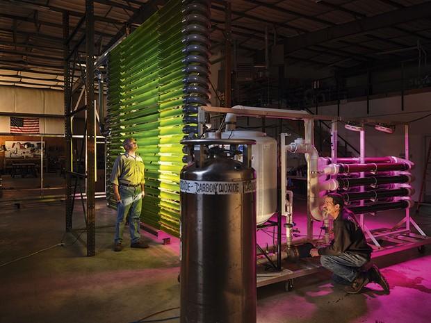 Two men looking at a bioreactor © Luca Locatelli/Institute