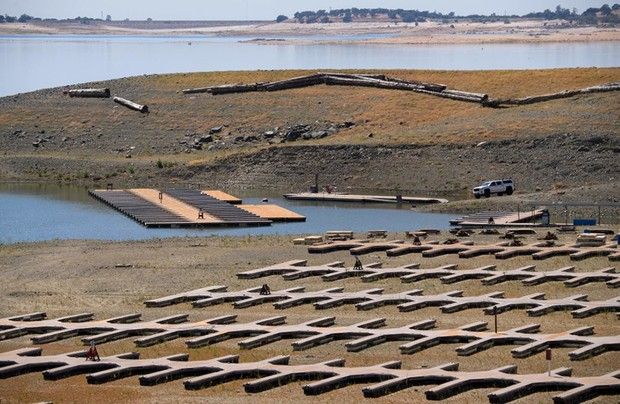 Empty boat slips sit on a dry lake bed at Folsom Lake Marina as the lake experiences lower water levels during the California drought emergency on May 27, 2021 in El Dorado Hills, California. - On May 10, California Governor Gavin Newsom declared a state of drought emergency in 41 counties, including El Dorado County where Folsom Lake is located. (Photo by Patrick T. FALLON / AFP) (Photo by PATRICK T. FALLON/AFP via Getty Images)
