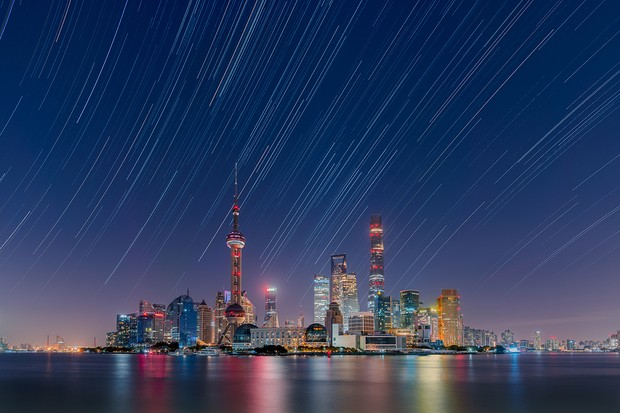 Star trails over the Lujiazui City Skyline © Daning Kai