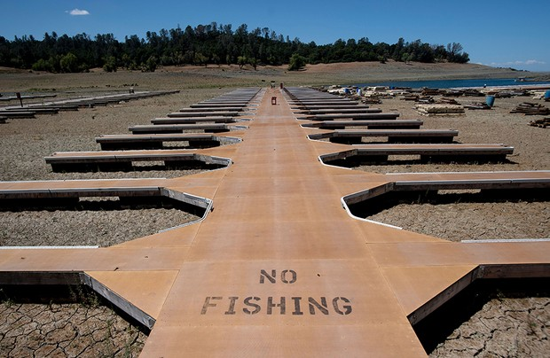 Mandatory Credit: Photo by Josh Edelson/AP/Shutterstock (12008958d) Empty boat docks sit on dry land at the Browns Ravine Cove area of drought-stricken Folsom Lake, currently at 37% of its normal capacity, in Folsom, Calif., . California Gov. Gavin Newsom declared a drought emergency for most of the state California Drought Reservoirs, Folsom, United States - 22 May 2021