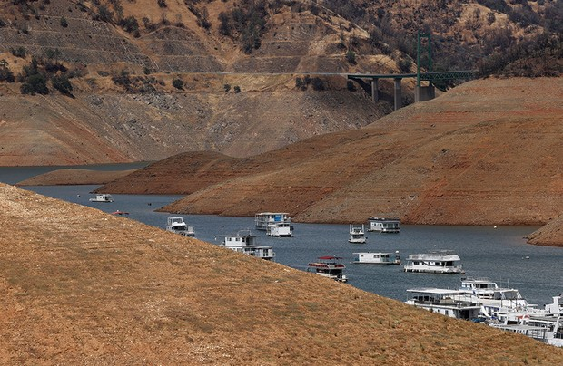 Mandatory Credit: Photo by JOHN G MABANGLO/EPA-EFE/Shutterstock (12079872a) Houseboats float below normal levels at the Bidwell Canyon Marina on Lake Oroville in Oroville, California, USA, 14 June 2021. Many owners are leaving their boats in the water instead of taking them to dry dock as water levels are at a record low due to chronic drought in the west of the United States. Numerous counties of California are now under a drought state of emergency and the California Governor Gavin Newsom is asking Californians to conserve water. Lake Oroville at low levels in California drought, USA - 14 Jun 2021