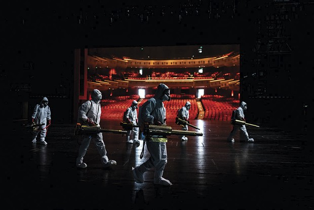 The Time of Coronavirus by Aly Song. Volunteers from the Blue Sky Rescue Team, the largest humanitarian NGO in China, are pictured disinfecting the Qintai Grand Theatre in Wuhan, near to where the COVID-19 pandemic began © Aly Song/Wellcome Photography Prize 2021