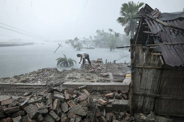 A man named Haibur is salvaging belongings from the wreckage of his house, three months after Cyclone Amphan hit Bangladesh © Zakir Hossain Chowdhury/Wellcome Photography Prize 2021