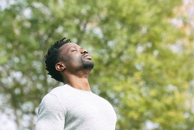 A person breathing deeply © Shutterstock