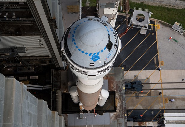 A United Launch Alliance Atlas V rocket with Boeing's CST-100 Starliner spacecraft aboard is seen as it is rolled out of the Vertical Integration Facility to the launch pad at Space Launch Complex 41 ahead of the Orbital Flight Test-2 (OFT-2) mission, Monday, Aug. 2, 2021 at Cape Canaveral Space Force Station in Florida. Boeing's Orbital Flight Test-2 will be Starliner's second uncrewed flight test and will dock to the International Space Station as part of NASA's Commercial Crew Program. The mission, currently targeted for launch at 1:20 p.m. EDT Tuesday, Aug. 3, will serve as an end-to-end test of the system's capabilities. Photo Credit: (NASA/Aubrey Gemignani)