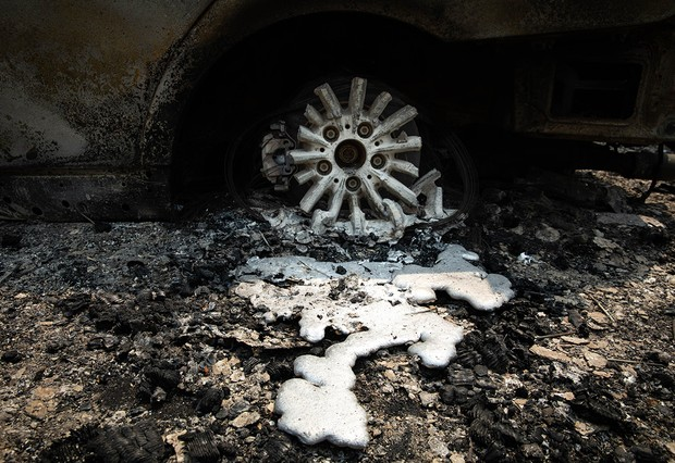 GREENVILLE, CA - AUGUST 08: A tire and wheel melted from the Dixie Fire on August 8, 2021 in Greenville, California. The Dixie Fire, which has incinerated more than 463,000 acres, is the second largest recorded wildfire in state history and remains only 21 percent contained. (Photo by Maranie R. Staab/Getty Images)