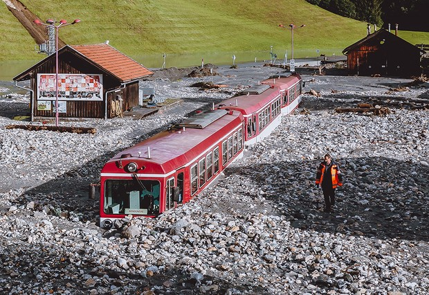 TOPSHOT - A stucked train after flooding is pictured in Wald im Pinzgau near Salzburg, Austria, on August 17, 2021. - Storms have battered large parts of Austria since late August 16 with landslides and flooding hitting especially Austrias western regions of Pinzgau and Pongau in the state of Salzburg, bordering Germany. Some 100 people stuck in cars as landslides hit roads had to be rescued, while three people have been injured. - Austria OUT (Photo by JFK / various sources / AFP) / Austria OUT (Photo by JFK/EXPA/AFP via Getty Images)