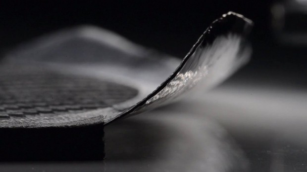 A thin sheet of carbon fibre bending into a wing shape © Carmel Snow