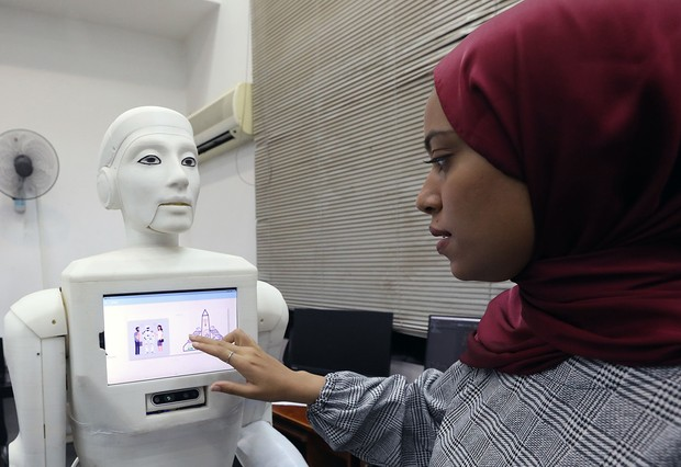 Mandatory Credit: Photo by KHALED ELFIQI/EPA-EFE/Shutterstock (12257307b) Egyptian engineer Hager gives an order to a robot nurse invented by the faculity of computer and information science at Ain Shams University in Cairo, Egypt, 11 August 2021. The nurse robot helps in reducing direct contact between the medical staff and patients at time of the coronavirus pandemic in order to reduce the infection risk for the medical staff. It can also conduct video calls between patients and doctors, deliver medications, and sterilize the rooms. Robot Nurse for Covid-19 in Egypt, Cairo - 11 Aug 2021