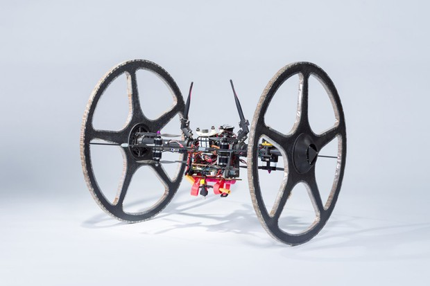 Rollocopter, a hybrid aerial and land platform, uses a quadrotor system to fly or ride on two passive wheels.  This design gives the robot a greater range than air-only quadrotors and eliminates obstacle avoidance issues associated with ground-only robots.  When Rollocopter encounters an obstacle, it can simply hover over it.  To fly this robot requires a celestial body with an atmosphere and could be used to explore underground caves from other worlds.  Photo by NASA / JPL