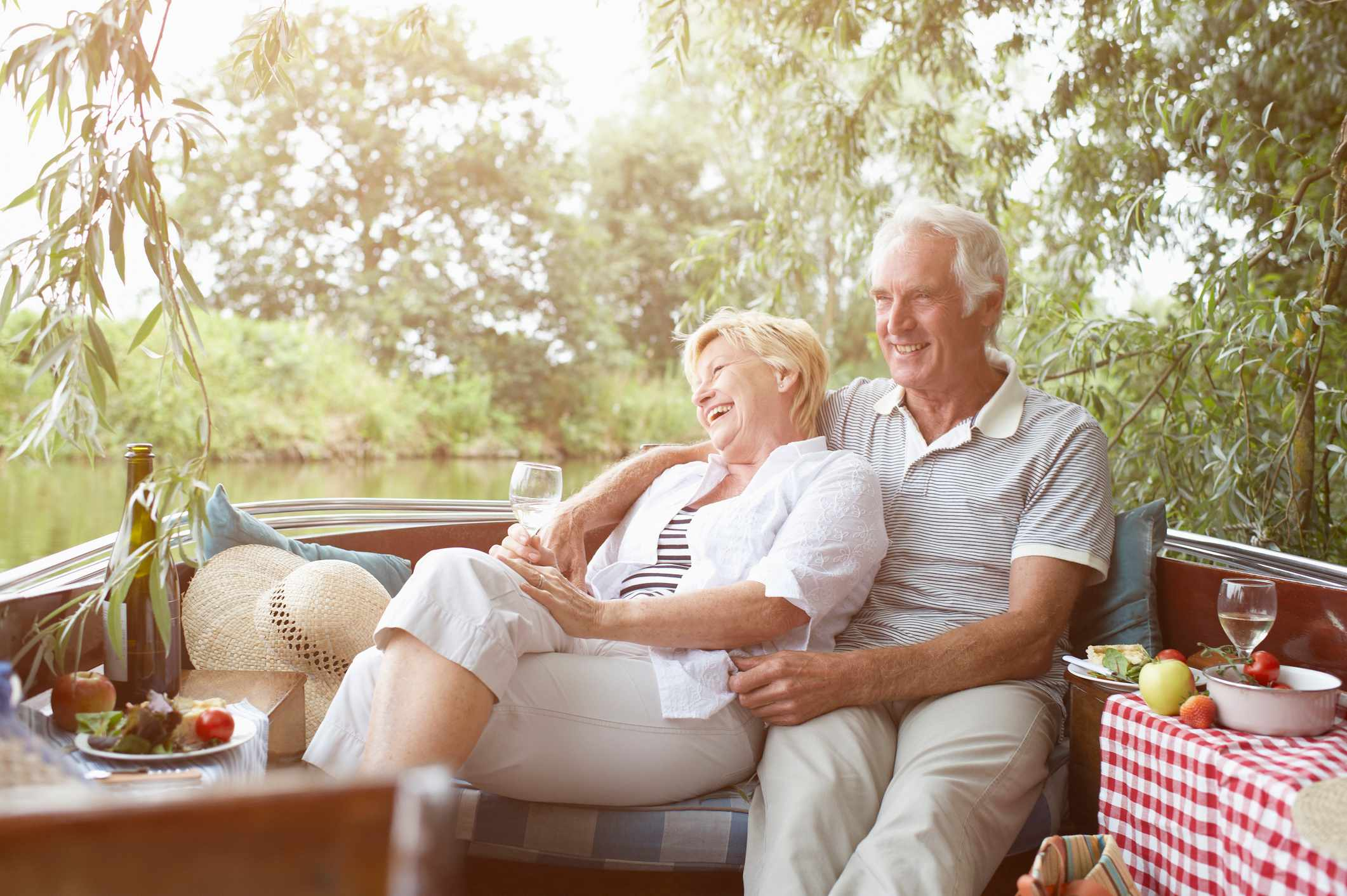 Senior couple relaxing in vintage boat.