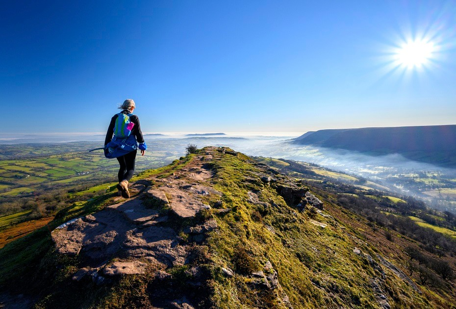 Mature woman hiker on Black Hill (The Cat's Back) in the Black Mountains, Brecon Beacons national park
