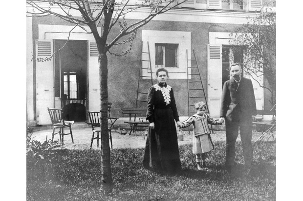 c1899: Marie Curie and her husband, French chemist Pierre Curie hold hands with their daughter, Irene. (Photo by Hulton Archive/Getty Images)
