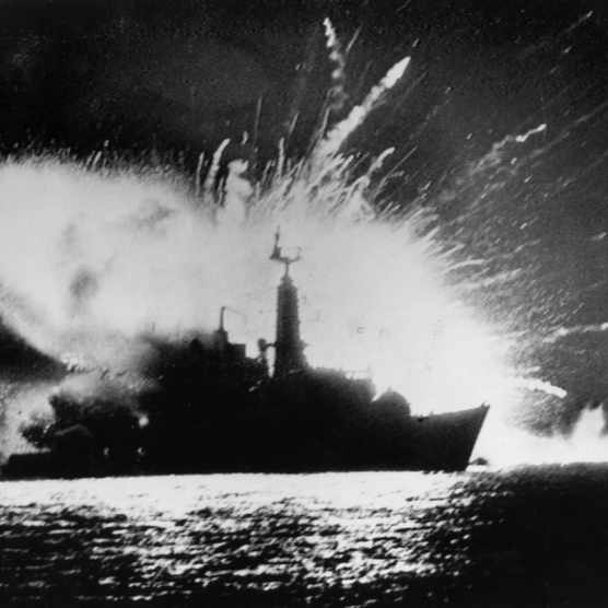 British Royal Navy Type 21 frigate HMS Antelope explodes in San Carlos Water, off East Falkland, after attacks by the Argentine Air Force during the Falklands War, 24 May 1982. (Photo by Martin Cleaver/Pool/Getty Images)